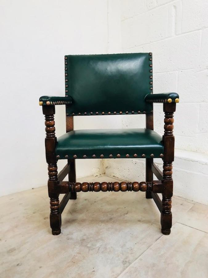 Large oak leather studded armchair